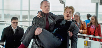 Paul Bettany carrying Johnny Depp Mortdecai