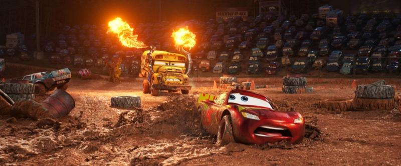 Lightning McQueen (Owen Wilson) being chased by Miss Fritter (Lea DeLaria) in Cars 3