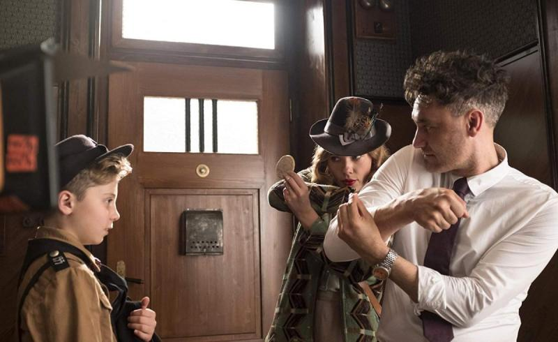 Roman Griffin Davis, Scarlett Johansson and Taika Waititi block a scene on Jojo Rabbit