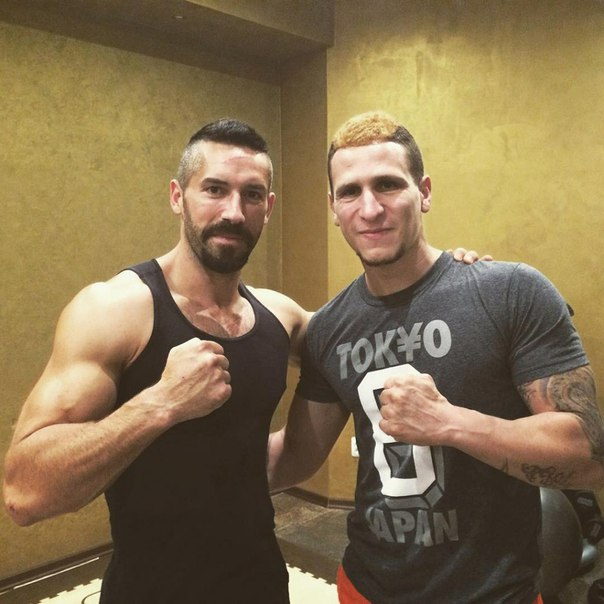 Brahim Achabbakhe with Scott Adkins