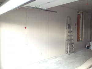The wall in the garage is finished plastered.
