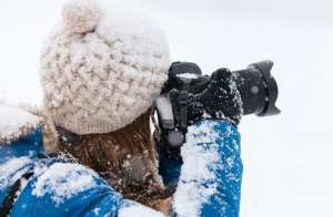 A girl shooting in cold weather.