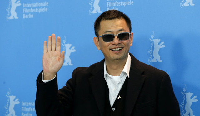 """Director Wong Kar-Wai poses during a photocall to promote the movie """"The Grandmaster"""" at the 63rd Berlinale International Film Festival in Berlin"""