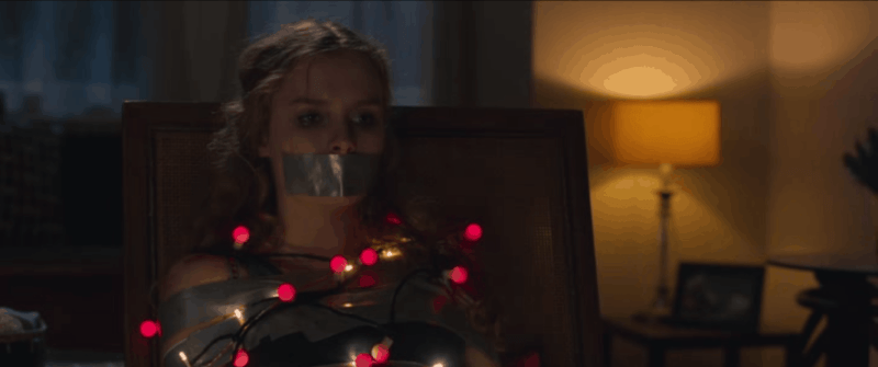 better watch out movie a woman is tied up with a string of Christmas lights with her mouth duct taped