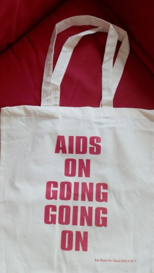 Visual AIDS totebag with image by Kay Rosen handed out at (re)Presenting AIDS