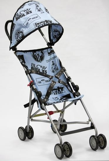 John Waters, Bill's Stroller, 2014, Umbrella lightweight stroller with silkscreened linen and spiked, leather belt (Courtesy the artist and Marianne Boesky Gallery, New York)