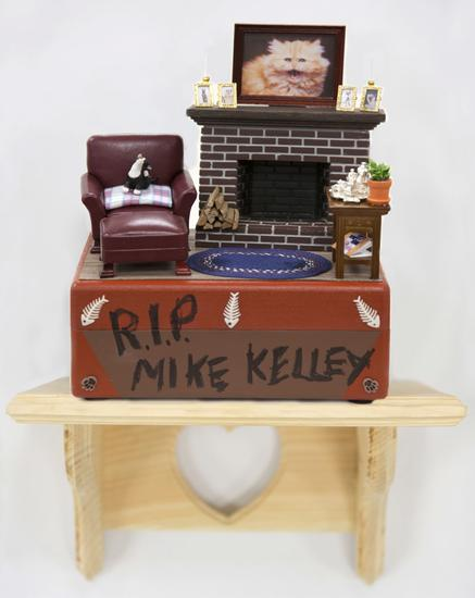 John Waters, R.I.P. Mike Kelley, 2014 Hand-painted cat urn with decorative detail, clear knotty pine shelf with engraved heart detail