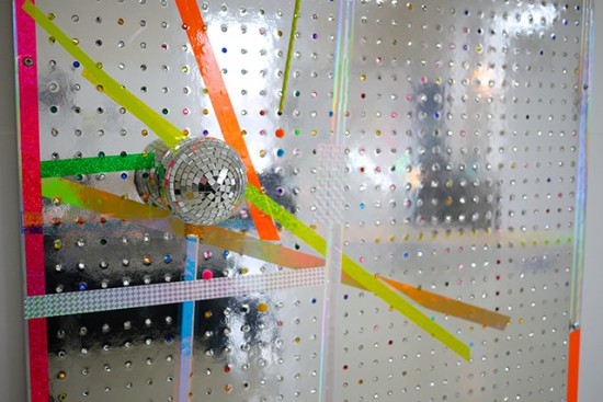 Bradley Wester  Shine (detail), 2015 Holographic tape, mirror ball, nylon cord, puff balls, inlayed plastic jewels on custom Mylar pegboard and extruded aluminum