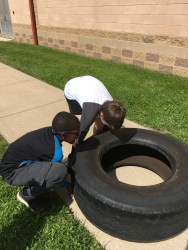 Two students take on the tire flip as it was their last circuit in this workout. (Photo/Jaryd Leady)
