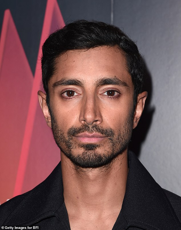 Looking good: The Emmy Award winner shot a serious expression towards photographers as he wore his dark brown tresses in a sleek side parting