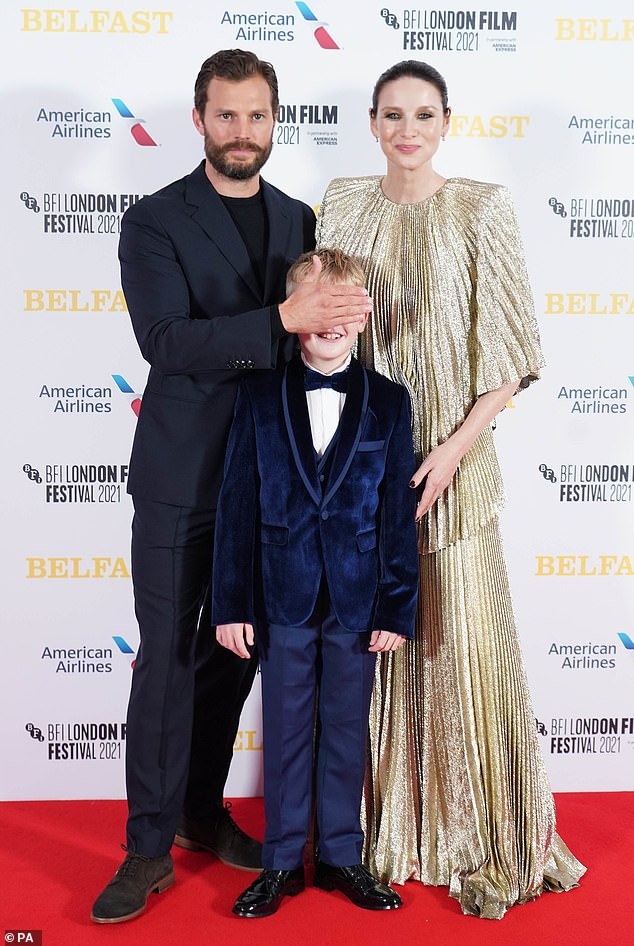 Funny: Jamie appeared to be in a jovial mood as he placed his hand over child actor Jude's eyes while they posed for snaps