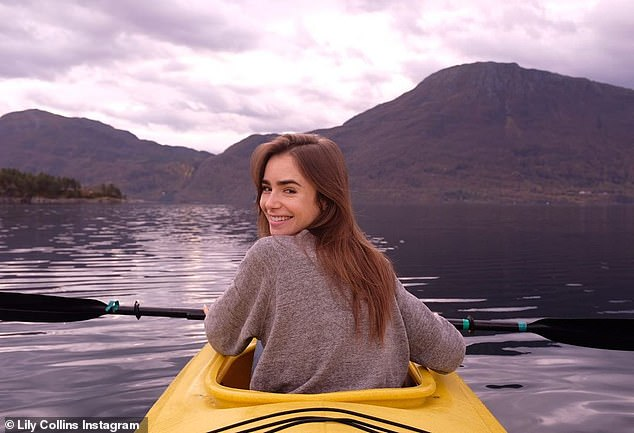 Adorable:Lily shared two snaps of herself posing in front of the stunning scenery as well as on a canoe