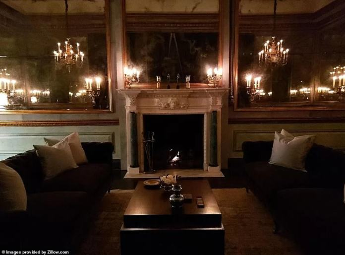 Musk's home was not without luxuries and the library has leather walls and a fireplace while the music room features a hydraulic lift to combine the space with the dining room for a sweeping event space