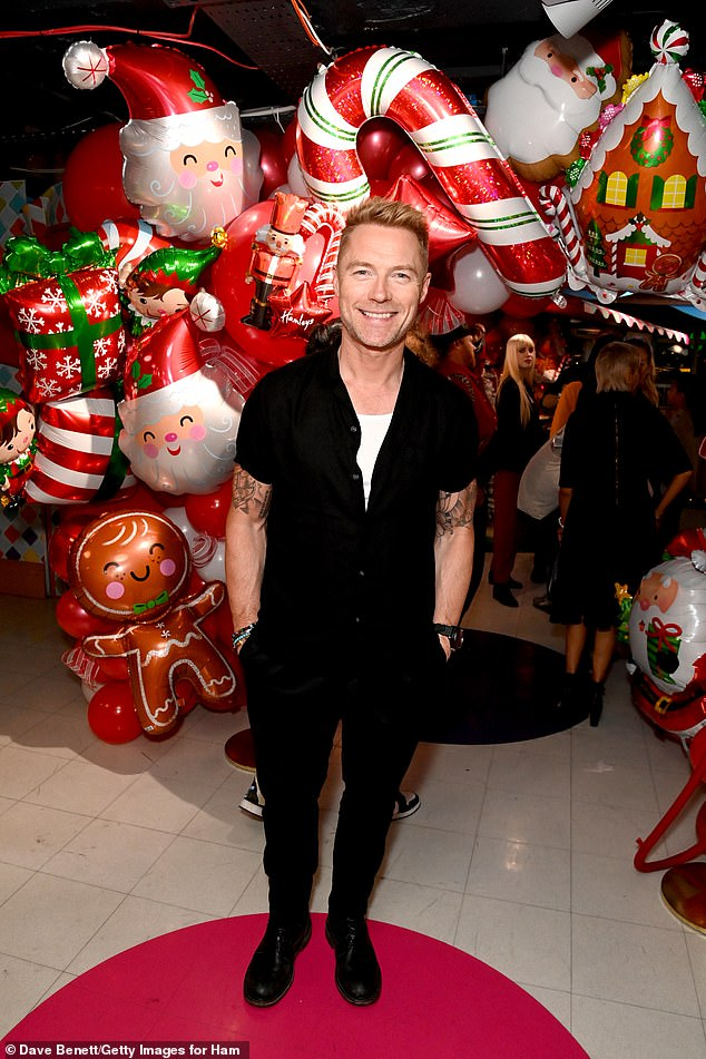 Crooner: Ronan Keating looked handsome in an all-black ensemble
