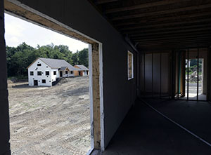 A zero net energy home under construction in July at The Preserve at Mountain Vista in New Paltz, N.Y. The Commerce Department reported a 6 percent ride in housing starts in July compared with the previous month. (AP File Photo: Mike Groll)
