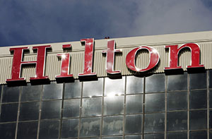 The sign atop the Hilton Los Angeles Airport hotel is seen in this 2007 file photo. Hotel operator Hilton Worldwide Holdings Inc. plans to raise $1.25 billion from an initial public offering of its common stock. The McLean, Va. company, founded in 1919, was taken private by investment firm The Blackstone Group in October 2007. (AP file photo: Reed Saxon)