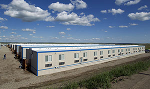 More than 20,000 people have poured into eastern Montana and western North Dakota since oil production began its meteoric rise in 2008. Tens of thousands more are expected in the next several years as the boom continues. This 2011 photo shows temporary housing outside of Williston, N.D. (AP file photo)
