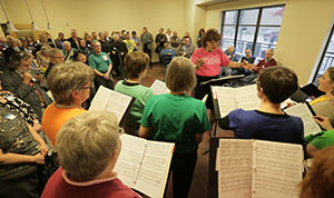 A.P. Hopper, assistant director of the Calliope Women's Chorus, conducts a rehearsal at Spirit on Lake Apartments. Calliope is the second-oldest feminist choir in the country and includes women of all sexual orientations. (Staff photo: Bill Klotz)