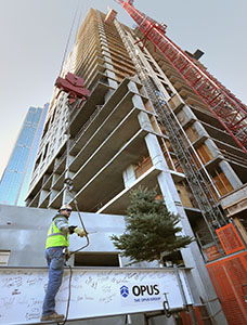 "A steel beam is hoisted to the top of the 26-story Nic on Fifth building at 415-427 Nicollet Mall in Minneapolis as part of a ""topping off"" ceremony Wednesday. The project is scheduled for completion in summer 2014. (Staff photo: Bill Klotz)"