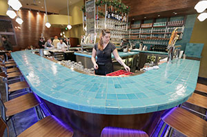 The blue tile wine bar in the French Meadow Bakery & Café's Bluestem Bar in Minneapolis represents water, one of the five elements of feng shui. (Staff photo: Bill Klotz)