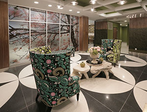 Soo Line Building City Apartments' lobby provides a concierge, public seating and a tenant-only greeting area filled with colorful and funky furniture. (Staff photo: Bill Klotz)