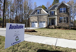 A home is advertised for sale Nov. 14 in Matthews, N.C. U.S. home prices barely rose in November from the previous month and year-over-year gains slowed, reflecting declines in sales in the fall, according to a report Jan. 7 from real estate data provider CoreLogic. (AP file photo: Chuck Burton)