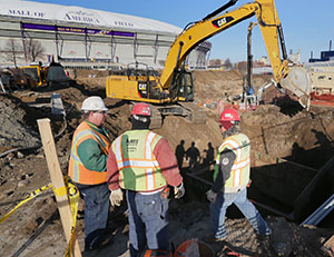 Crews from Ames Construction on Monday dig into the Metrodome's east parking long along 11th Avenue in downtown Minneapolis. Work continues despite a lawsuit that has delayed the sale of bonds for the project. (Staff photo: Bill Klotz)