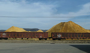 """In this March 2012 photo, rail cars are seen near a pile of silica sand dubbed """"Mount Frac"""" in Winona, Minn. (AP photo: Minnesota Public Radio)"""