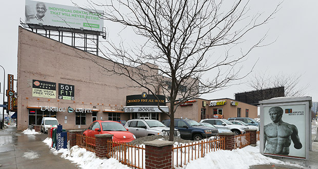 The 30,000-square-foot commercial building at 501 Washington St. S. in Minneapolis includes a Caribou Coffee, the Crooked Pint Ale House and other retailers. The property is a block north of Ryan Cos. US Inc.'s Downtown East mixed-use project. (Staff photo: Bill Klotz)