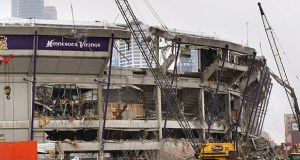 A wrecking ball tore into a portion of the Metrodome on the northeast corner of the building Wednesday. Stadium work is advancing with demolition, site work and solicitation of proposals for more steel work. (Staff Photo: Bill Klotz)