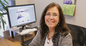 Donna Ploof, a senior solutions consultant with Hopkins-based Trusted Employees, has performed background checks for 20 years. (Staff photo: Bill Klotz)