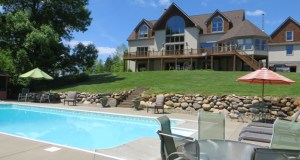 This five-bedroom lodge style home and 40 acres of land at 10685 County Road 24 in Watertown Township sold recently for $1.36 million. (Submitted photo: Coldwell Banker Burnet)