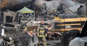 This July 6, 2013, photo shows a worker moving through the wreckage of the oil train derailment and explosion in Lac-Megantic, Quebec. (AP file photo)