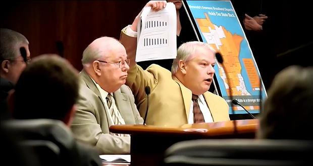 Greater Minnesota Partnership Executive Director Dan Dorman, holding up papers, testifies in front of a legislative committee. (Submitted photo)