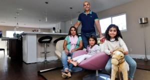 """Jumbo mortgages are a necessity for nearly everyone in communities such as La Jolla, Calif. That's where Aniqa Jaswal, left, and her husband, Imran, standing, bought a four-bedroom house. """"There are no homes below jumbo mortgage prices here,"""" Aniqa Jaswal said. (AP photo: Lenny Ignelzi)"""