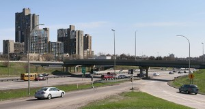 """Interstate 35W is """"the trench"""" that divides downtown Minneapolis from the University of Minnesota's West Bank, said Collin Barr, president of Ryan's NorthCentral Region and chairman of the Downtown Council board. Barr and others want to build a """"lid"""" over the a portion of the interstate south of the Washington Avenue bridge to better connect the two parts of the city. (Staff photo: Bill Klotz)"""