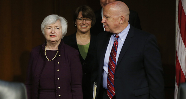 Federal Reserve Chair Janet Yellen arrives Wednesday to testify before the congressional Joint Economic Committee. With her are the committee's chair, Rep. Kevin Brady, R-Texas, right, and the vice chair, Sen. Amy Klobuchar, D-Minn. (AP photo)