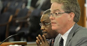 Detroit Democratic Rep. Thomas Stallworth III listens Tuesday as Rep. John Walsh, R-Livonia, speaks to the Michigan Senate Committee on Government Operations about bills associated with easing Detroit's bankruptcy. (AP Photo: Detroit News)