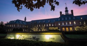 In this Nov. 20, 2013, photo, the sun sets behind the Fannie Mae headquarters in Washington. Alleged insurance kickbacks collected by banks and other mortgage servicers may have cost government-controlled mortgage giants Fannie Mae and Freddie Mac an estimated $168 million, according to an inspector general's report. (AP Photo: J. David Ake)
