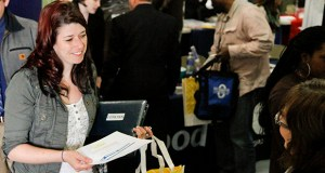 Jessica Bowen, left, talks with Sandra Modena, sales manager at Trillium Staffing, at the annual veterans job fair in downtown Muskegon, Mich. (AP photo: The Muskegon Chronicle)