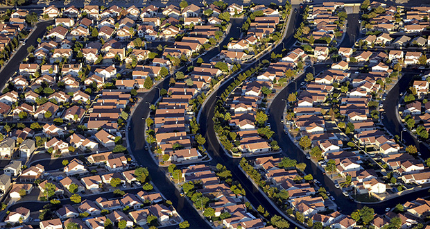U.S. home-price gains have restored $3.8 trillion of value to owners since 2012, according to Federal Reserve data. A record number of Americans are using that equity to pay cash for properties. This photo shows rows of houses in Las Vegas, Nevada. (Bloomberg News file photo)