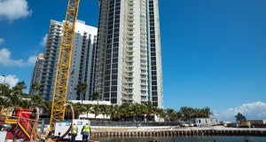 A construction crane stands next to the site of the Porsche Design Tower in Miami Beach, Florida, on Feb. 11. Miami, just four years ago the poster child for overleveraged condo buyers who walked away as values plummeted, is turning a new page. (Bloomberg News file photo)