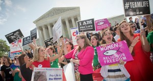 Demonstrators react to the Supreme Court's decision on the Hobby Lobby case Monday outside the Supreme Court building in Washington. (AP Photo: Pablo Martinez Monsivais)