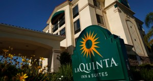 La Quinta Holdings Inc. signage is displayed outside of a hotel location in Hawaiian Gardens, California. Limited service hotels like La Quinta are drawing interest from investors swayed by lower operating costs and higher returns for the properties compared with higher end hotels. (Bloomberg News photo)