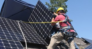 Solar leases were introduced in 2008 and started to take off in about 2012. In this photo, workers install solar electric panels on the roof of a house in Park Ridge, Illinois. (Bloomberg News file photo)
