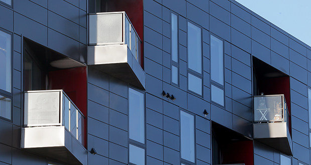 Architect Julie Snow crafted a reserved, gun-metal gray panel exterior much different from the traditional brown-and-red brick exterior found in the North Loop and Warehouse District. (File photo: Bill Klotz)