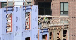 Construction is nearing its end for the Elan Uptown, a 591-unit apartment complex being constructed on several blocks along the Midtown Greenway in Minneapolis. As many as 5,000 apartments could open in the Twin Cities over the rest of the year. (Staff photo: Bill Klotz)