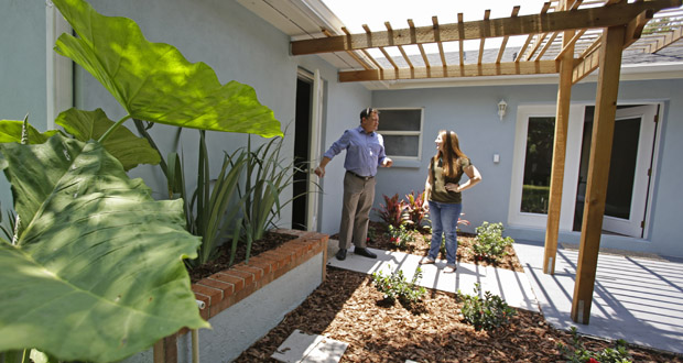 Real estate agent Greg Gammonley, left, shows a home to prospective buyer Maddie Coker on May 23 in Orlando, Florida. A report released Wednesday suggests millennials are not less likely to buy homes than previous generations. (AP photo)