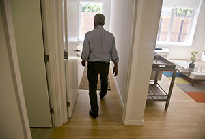 Jeffrey M. Brown walks July 9 through a two-bedroom apartment in the seven-story modular apartment building, called the Stack, that he co-developed in the Innwood neighborhood of New York. (AP photo: Bebeto Matthews)