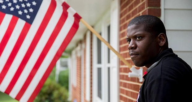 Air Force Staff Sgt. Claude Hunter, a radio communication supervisor at Andrews Air Force Base, stands at his house in Waldorf, Maryland. Using a Veterans Affairs mortgage, he paid $219,000 in May for the four-bedroom house. (Bloomberg News: Andrew Harrer)